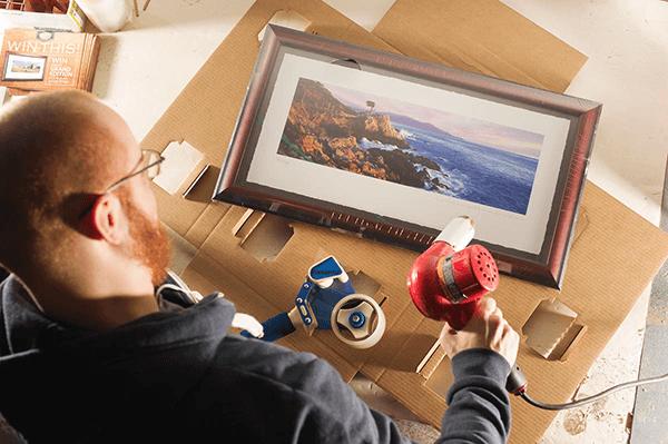 Stonehouse Golf - Preparing framed print for shipping.